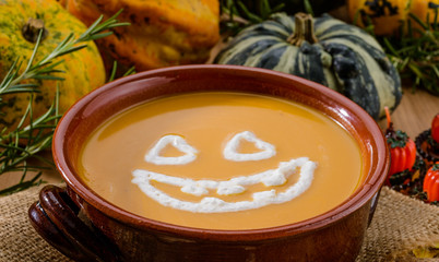 Pumpkin soup for Halloween party, close-up