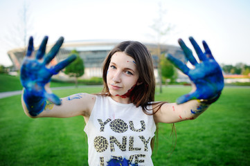 girl with blue hands. photoshoot with paints