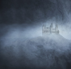 An old castle on a dark and foggy background
