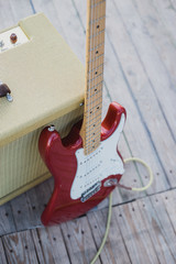Yellow vintage guitar aplifier with cable and electric guitar