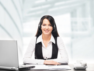 Young, confident and beautiful customer support operator working