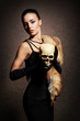 Beautiful woman with a scull on a vintage background
