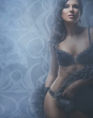 Fashion shoot of a beautiful woman in luxury lingerie