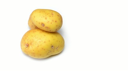 Potatoes rotating on white background