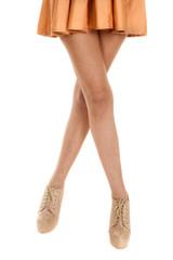 woman legs tan high heels orange skirt legs crossed
