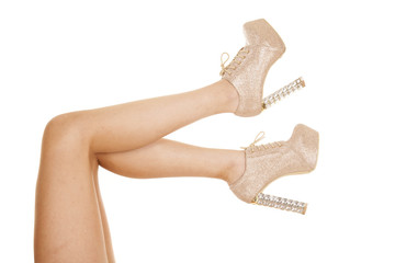 woman legs tan high heels up out