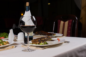 Glass of Red Wine on Table with Dinner