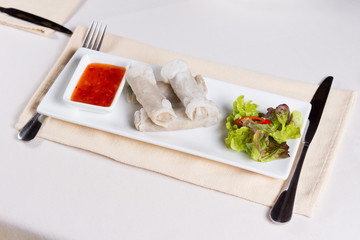 Overhead of Spring Rolls on Plate