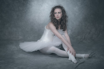 Ballet fashion style brunette woman. Wearing white corset and dr