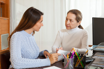 Employee interviewing young woman