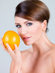 Close up Gorgeous Woman Holding Orange Fruit
