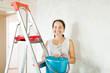 woman makes repairs at home