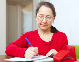 mature woman is calculated  family budget