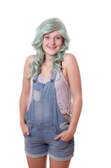 young woman with green hair and jeans dungarees