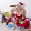 Female party goer in fancy dress drinking alcohol
