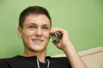 Teenager smiling while talking on cell phone