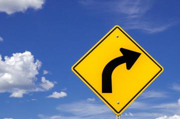 Road Sign Warning against Dangerous Curve