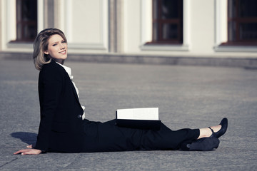 Happy young business woman with a folder