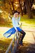 Pretty blonde girl in blue dress outdoors