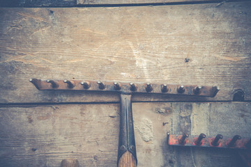 Vintage farm wall background with rakes