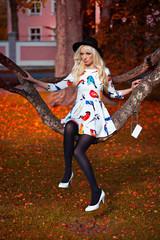 Lovely blonde girl in dress outdoors
