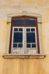 Aged window with peeling paint.