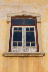 Aged window with peeling paint.