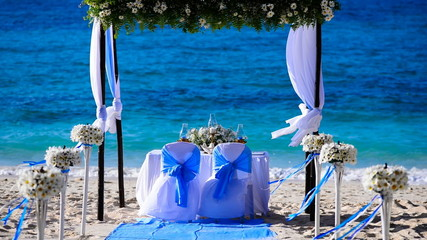 Decorated wedding table on the beach