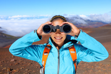 Hiker looking in binoculars