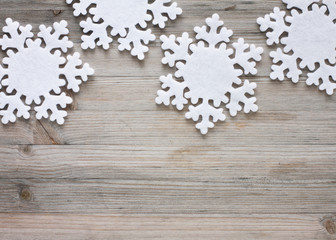 Snowflakes on old wood - background