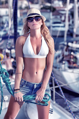 Sexy model posing on sailboat