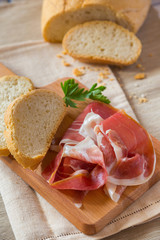 Bread and Ham Slices on a Cutting Board