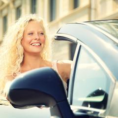 Woman driving car - female driver