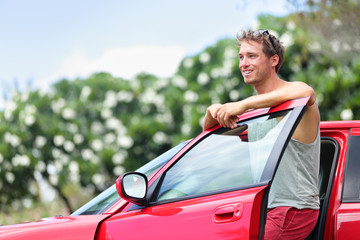 Car owner - young man and new red car outside