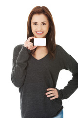 Casual happy woman with business card