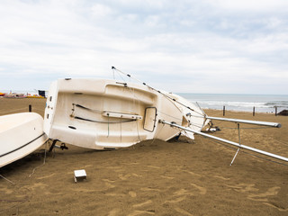 The boat overturned on the beach.