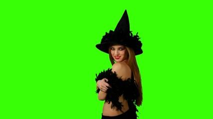 Halloween redheaded witch on green screen. Halloween.