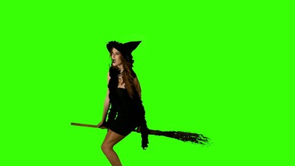Halloween witch flying on a broomstick green screen