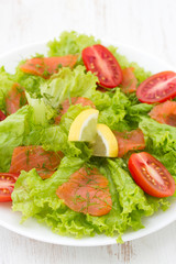 salad with smoked fish on plate
