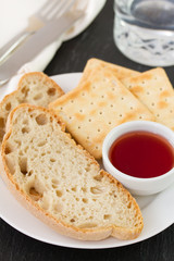 bread with jam and glass of water
