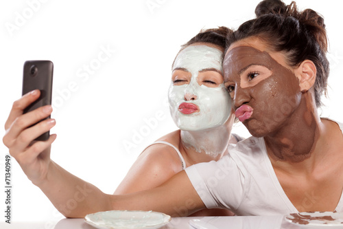 Two young women with masks making selfie - 71340949