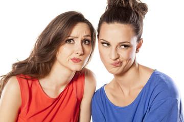 Two beautiful young women complain