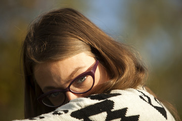 Young Girl With Glasses Looking over Shoulder