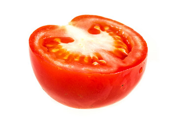 Ripe organic tomato half isolated on white background in a studi