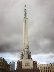 freedom monument in riga latvia with atorm clouds behind