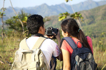 Asian couple backpackers