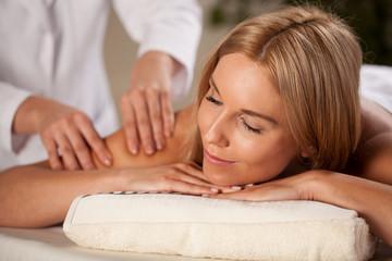 Beautiful woman having arm massage