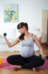 Pregnant woman practicing at home