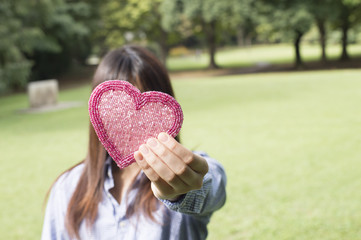 Women hold out those in the form of heart