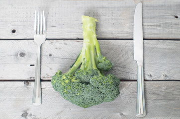Fresh broccoli on aged wooden table